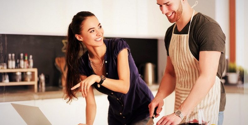 couple taking online cooking class for date night